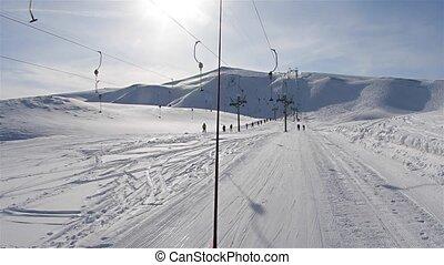 Ski lift pulling - Using ski lift, winter sorts