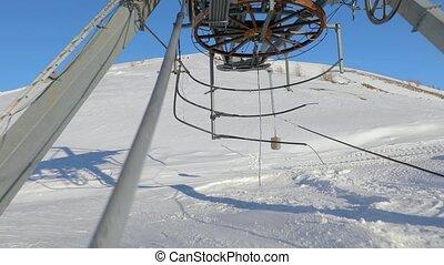 Ski lift pulling - Using ski lift, arriving at the top