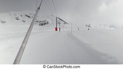 Using ski lift, pulling button lift in the swiss alps