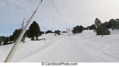 Using ski lift, winter sports in Chmrousse, France, pulling skilift in 4k 60p