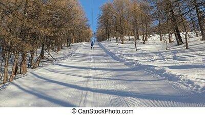 Ski lift pulling - Using ski lift, winter sports in Val d'...