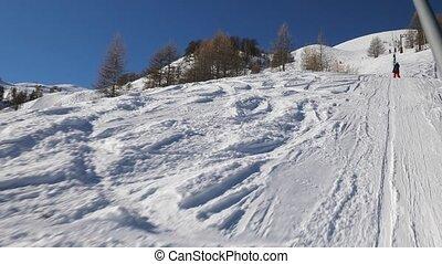Ski lift pulling - Using ski lift, winter sports in Val...