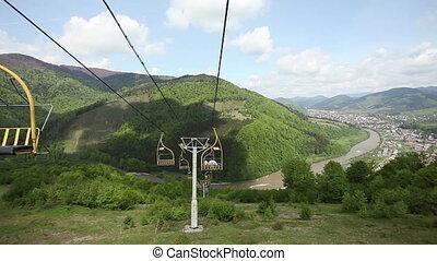 Ski lift riding - Breathtaking mountain scenery with blue...