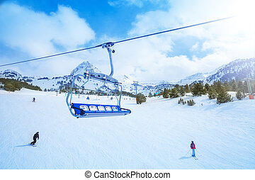 Ski lift seat over the pistes in mountains in Grandvalira ...