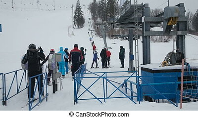 line of people ski lift