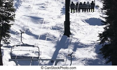 Ski lift with skiers and snowboarders - Ski resort in winter...
