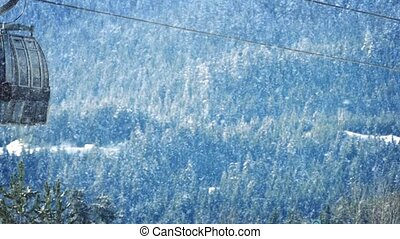 Ski Lifts Passing In Snowfall - Ski Lifts Passing With...