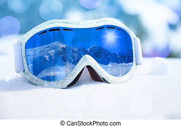 Close-up of ski and snowboard mask with mountain reflection in it