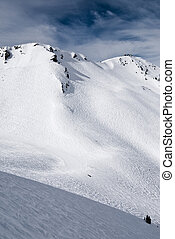 Ski paradise - Mountain slope with traces of skis