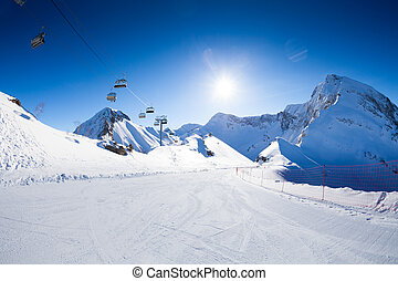 Ski piste panorama with ropeway chair lift