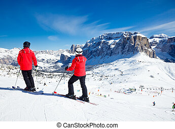 Ski Resort Area - Skiers overlooking the piste at Val Di ...