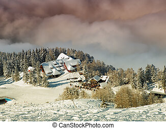 Ski resort - Clouds near the high mountain ski resort known...