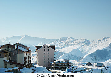 Ski resort high in the winter mountains