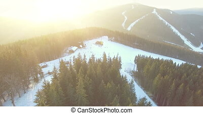 Ski resort in mountains. 4k 30fps - 4K Aerial Top View of...
