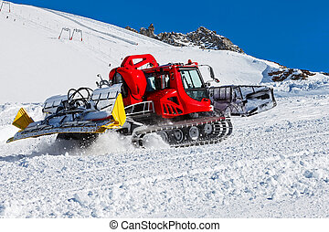 Ski resort maintenance - Photo of red snowcat in action on...