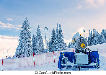 Ski resort with snow gun making new surface. - Snow cannon...