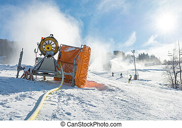 Ski resort with snow gun making new surface. Snowmaking for...