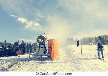 Ski resort with snow gun making new surface. Snowmaking for...