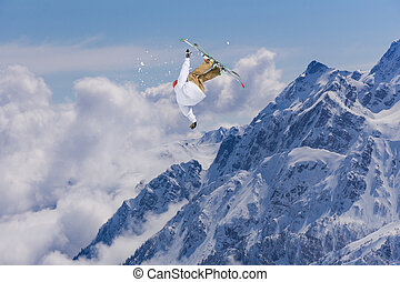 Ski rider jumping on mountains. Extreme freeride sport. -...