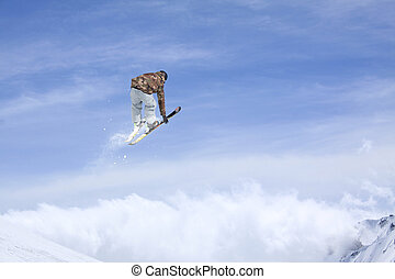Ski rider jumping on mountains. Extreme ski freeride. - Ski...