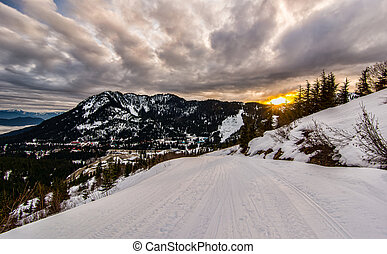 Ski Run at Sunset with Dramatic Clouds