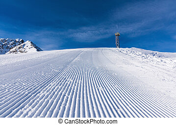 ski run trail snowcat - top of the ski slopes are prepared...