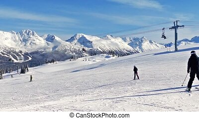 Ski Run With Many Skiers In Sun - Snowy landscape with...