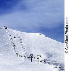Ski slope and chair-lift at morning. Caucasus Mountains. Georgia, region Gudauri, Mt. Kudebi.