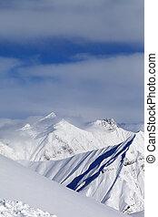 Ski slope and snowy mountains. Caucasus Mountains, Georgia, Gudauri.