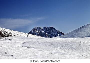 Ski slope at sunny day