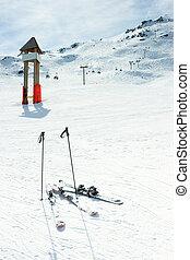 Ski slope - Blank signpost and skis on piste at ski resort