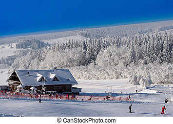 Ski slope - hut on the ski slope with skiers