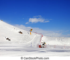 Ski slope with snowmaking at sun day. Greater Caucasus,...