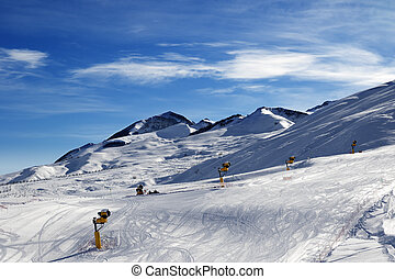Ski slope with snowmaking at sun morning. Greater Caucasus,...