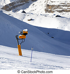 Ski slope with snowmaking on winter resort. Greater...