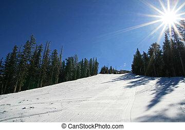 ski slope with sun