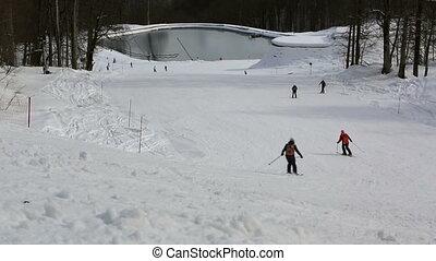 Ski slopes and artificial lake in Rosa Khutor Alpine Resort....