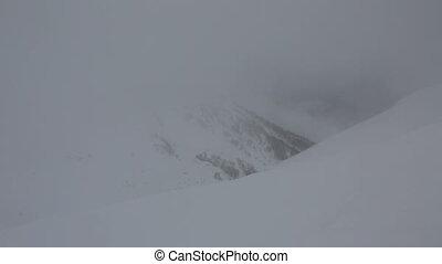 Ski slopes in fog at Rosa Khutor Alpine Resort. Time Lapse -...