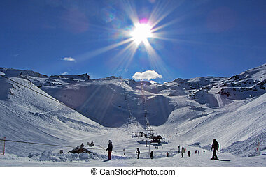 Ski Slopes in the Sun - Ski slopes in the French Alps, with...