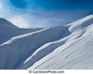 Ski slopes on sunny day in Austrian alps