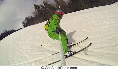 Ski sport man downhill at winter with slow motion