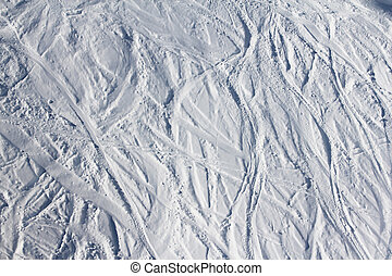 Ski traces on snow in mountains