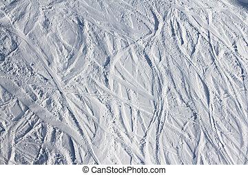 Ski traces on snow in mountains