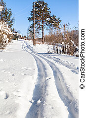 ski track at outskirt of russian village in winter