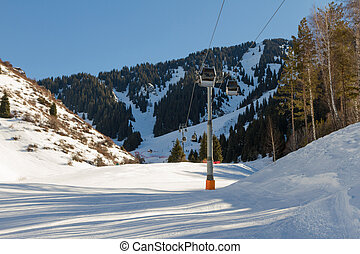 ski trail along the ski lift in the mountains of Tien Shan