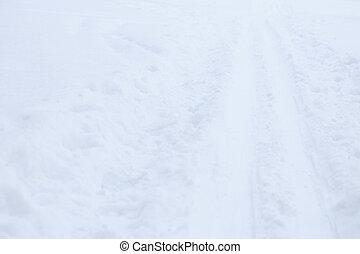 Ski trail texture. Ski run traces background. Snow skiing track surface.