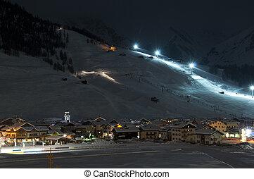 Ski village night scenario - Ski village at night with slope...