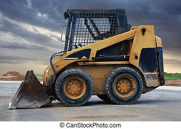 skid loader - a close up of a bobcat or a skid loader