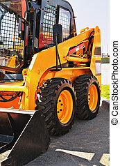 skid steer loader - Loader a tractor close up on grey...