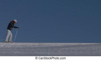 Skier walking over a snowed mountain ridge